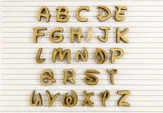 Papel alineado letras de madera de la escritura del alfabeto Fotografía de archivo