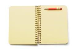 Papel amarelo do caderno e lápis vermelho Fotografia de Stock Royalty Free