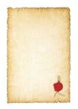 Papel amarilleado viejo con un sello de la cera Foto de archivo libre de regalías