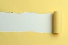 Papel amarillo rasgado Fotografía de archivo libre de regalías