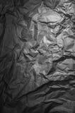 Papel arrugado gris oscuro Imagenes de archivo