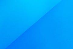 Papel azul de la pendiente Fotos de archivo