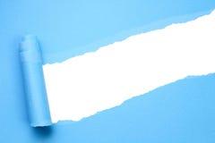 Papel azul rasgado fotografia de stock