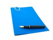 Papel azul y pluma Imagen de archivo libre de regalías