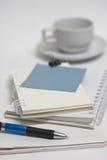 Papel con café Imágenes de archivo libres de regalías
