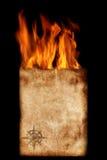 Papel con el compás y las llamas imagen de archivo