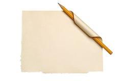 Papel con la esquina y el lápiz encrespados Imágenes de archivo libres de regalías