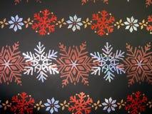 Papel con los copos de nieve Fotos de archivo libres de regalías