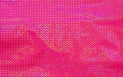 Papel cor-de-rosa com um teste padrão das listras fotografia de stock royalty free