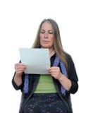 Papel da leitura da mulher Foto de Stock Royalty Free