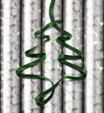 Papel de embalaje de la Navidad con la cinta verde en tapa Fotografía de archivo libre de regalías
