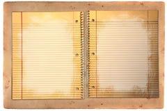 Papel de escola alinhado sujo em uma pasta Fotos de Stock