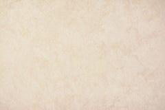 Papel de fundo da textura do ouro no creme amarelo do vintage ou na cor bege, papel de pergaminho, inclinação pastel abstrato do  fotos de stock