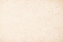 Papel de fundo de creme na cor bege do vintage, papel da textura de pergaminho, inclinação pastel abstrato do ouro com o marrom,  imagem de stock
