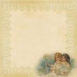 Papel de la Navidad con el marco y ángeles de lujo Imagen de archivo