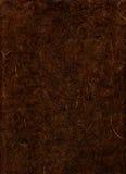 Papel de la textura de Brown oscuro Fotos de archivo libres de regalías