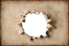 Papel de la vendimia con el agujero Foto de archivo libre de regalías