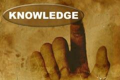 Papel de la vendimia con la mano y la palabra del conocimiento Foto de archivo libre de regalías
