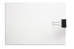 Papel de nota em branco e paper-clip isolados no branco Imagem de Stock Royalty Free