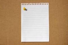 Papel de nota en blanco Fotos de archivo