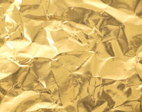 Papel de oro Fotos de archivo