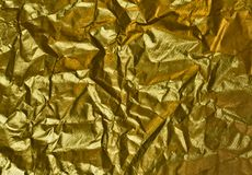 Papel de oro arrugado Imagenes de archivo