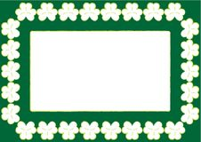 Papel de parede do St. Patrick com frame e shamrocks Foto de Stock