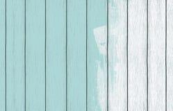 Papel de parede de madeira pintado do fundo com claro - pintura azul da cor imagem de stock royalty free