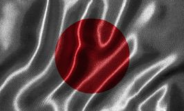 Papel de parede pela bandeira de Japão e pela bandeira de ondulação pela tela Fotografia de Stock