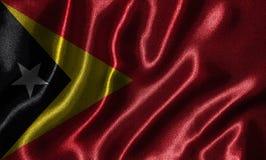 Papel de parede pela bandeira de Timor-Leste e pela bandeira de ondulação pela tela Foto de Stock Royalty Free