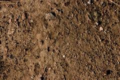 Papel de parede seco quente à terra do fundo da argila rochoso imagens de stock royalty free