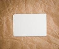 Papel del arte de Brown con una etiqueta en blanco Imágenes de archivo libres de regalías