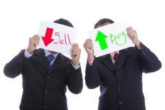 Papel del control del hombre de negocios para la acción de la venta y de la compra de la demostración Imagenes de archivo