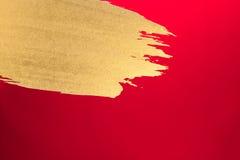 Papel del rojo de la tinta del oro Imagen de archivo libre de regalías