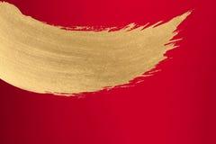Papel del rojo de la tinta del oro Fotografía de archivo