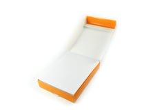 Papel e caixa de papel alaranjada Fotografia de Stock