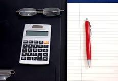 Papel e calculadora alinhados Imagem de Stock Royalty Free