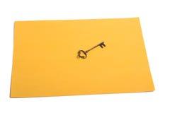 Papel e chave da cor Foto de Stock