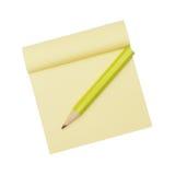 Papel e lápis amarelos de nota Foto de Stock Royalty Free