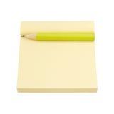 Papel e lápis amarelos de nota Imagens de Stock