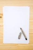 Papel em branco ou vazio com pena Fotografia de Stock