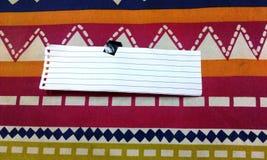 Papel em um fundo colorido Imagem de Stock