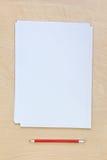 Papel en blanco con el lápiz Imágenes de archivo libres de regalías
