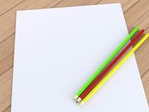 Papel en blanco con los lápices Imagen de archivo libre de regalías
