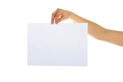 Papel en blanco en una mano Imágenes de archivo libres de regalías