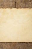 Papel envelhecido na madeira Foto de Stock Royalty Free