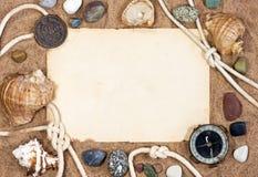 Papel, escudos do mar e corda velhos Fotografia de Stock
