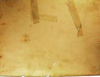 Papel frágil velho com fita foto de stock