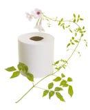 Papel higiénico con la flor fotografía de archivo libre de regalías