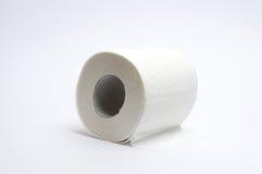 Papel higiénico no branco Imagens de Stock